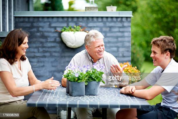 Sharing a chat with their grandson