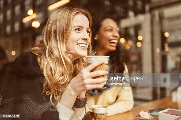 sharing a laugh with my friend - coffee drink stock pictures, royalty-free photos & images