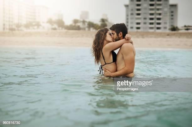 Sharing a passionate kiss