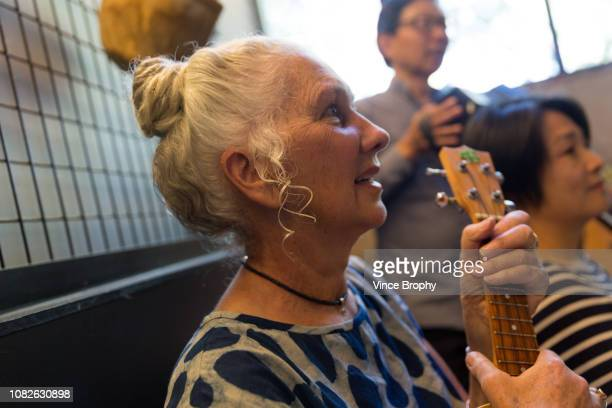 sharing a song with my friends - ukulele stock pictures, royalty-free photos & images