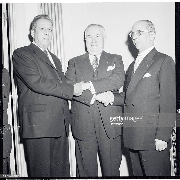 Sharing a three way handshake at the April 16th Luncheon for the Pan American Society of the United States to observe Pan American Day and to honor...