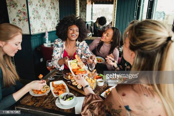 sharing food - friends stock pictures, royalty-free photos & images