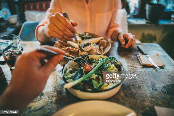 sharing food - salad stock pictures, royalty-free photos & images