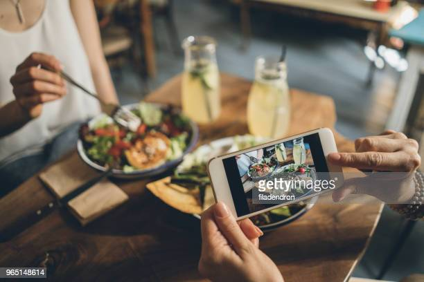 sharing food - restaurant stock photos and pictures