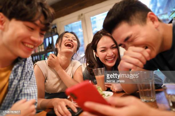sharing funny memories on smart phone - taiwan stock pictures, royalty-free photos & images