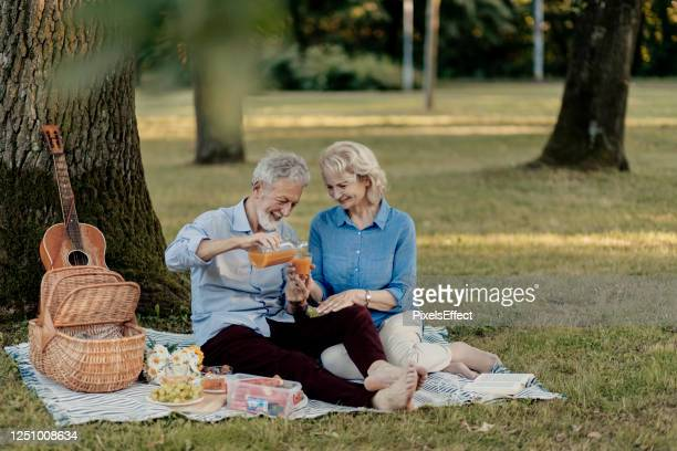 sharing good times - baby boomer stock pictures, royalty-free photos & images
