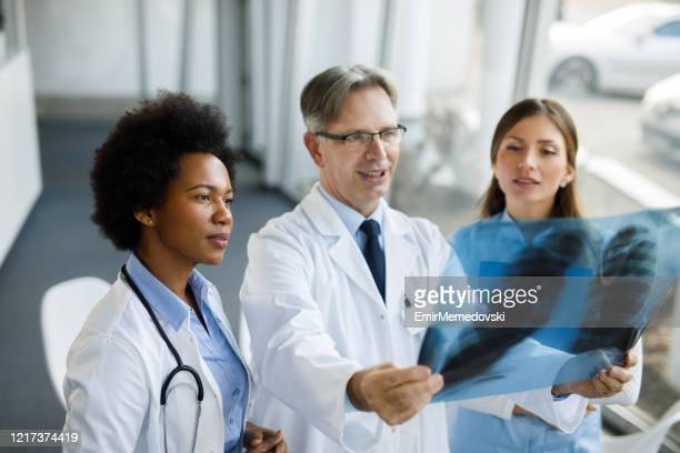 sharing his medical knowledge and wisdom - chest torso stock pictures, royalty-free photos & images