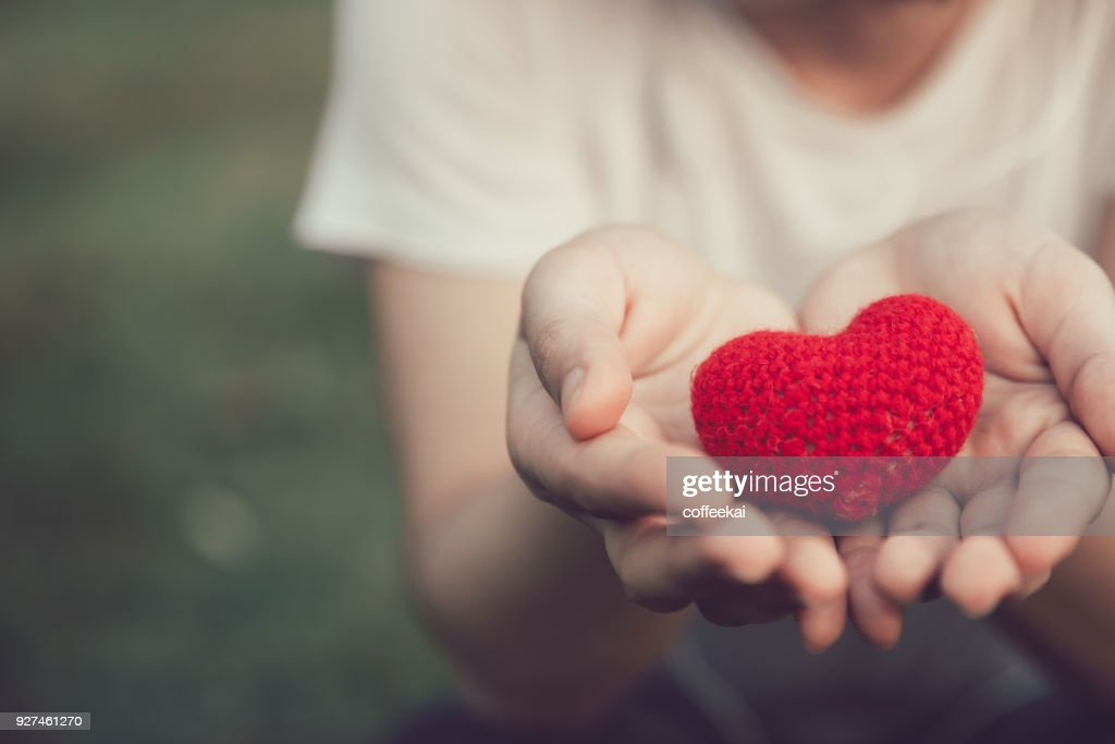 Sharing Love and Heart red color on women hand in valentine's day vintage color tone : Stock Photo