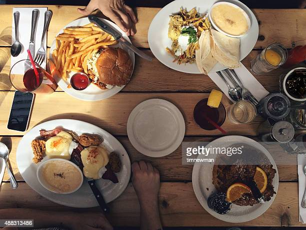 sharing meal together comfort food - chicken and waffles stock photos and pictures