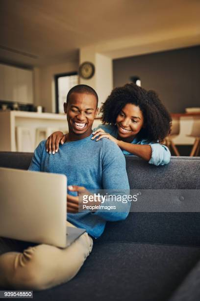 sharing some browsing time - girlfriend photos stock photos and pictures
