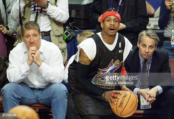 Sharing some VIP front row seats at the NBA All Star practices 09 February 2002 are CNN's White House Correspondent John King and former Clinton...