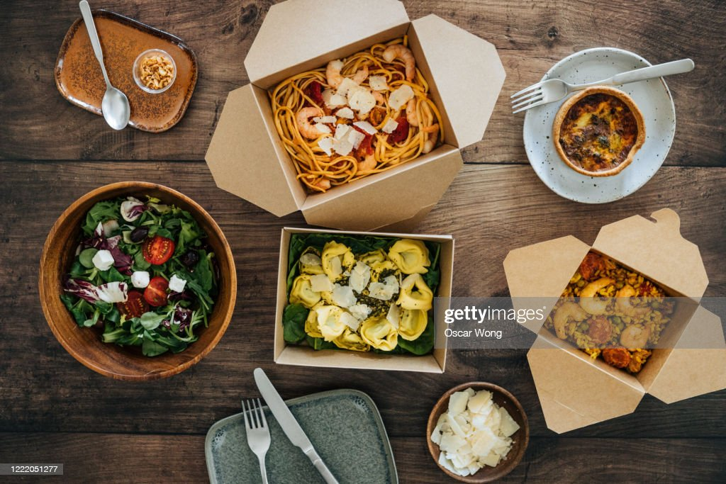 Sharing Takeaway Meal On Dining Table : Stock Photo