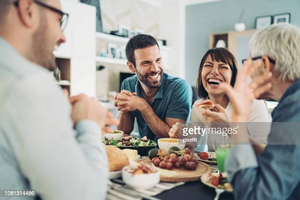 sharing the food and the good laughs - lunch stock pictures, royalty-free photos & images