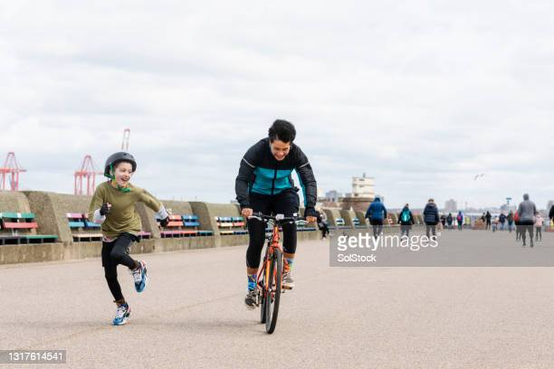 sharing the fun of riding - moving after stock pictures, royalty-free photos & images