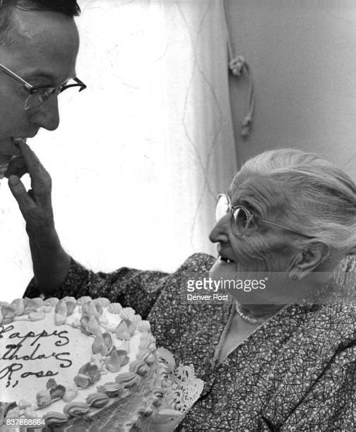 Sharing the Honors Mrs Kathy Rose who celebrated her 92nd birthday Tuesday gives a taste of her giant birthday cake to Clifford G Boyer of 1652 S...