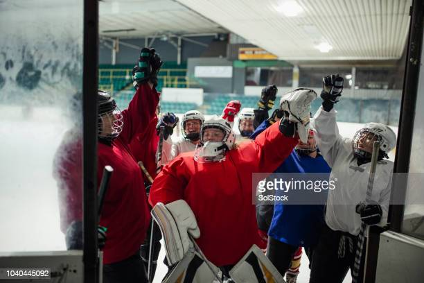 sharing the team spirit - ice hockey player stock pictures, royalty-free photos & images