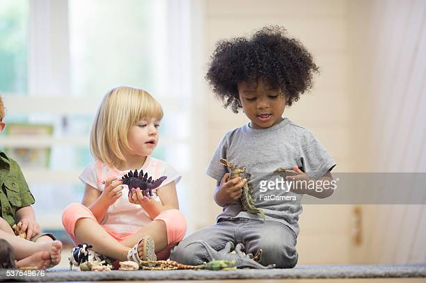 sharing toys - black ginger baby stock photos and pictures