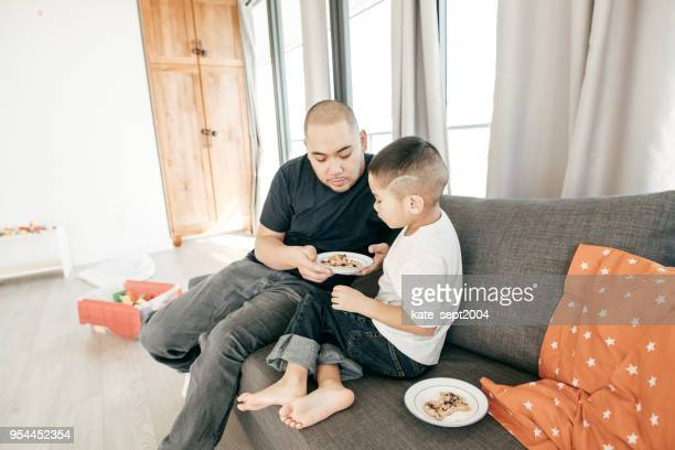 sharing with the others - filipino family eating stock pictures, royalty-free photos & images