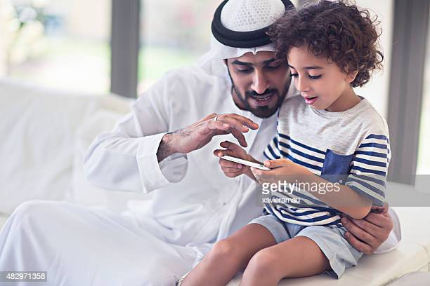 sharings time with his son - united arab emirates stock pictures, royalty-free photos & images
