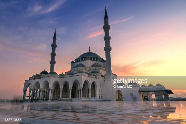 sharjah grand mosque - mosque stock pictures, royalty-free photos & images