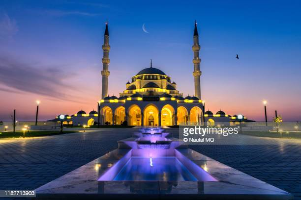 sharjah grand mosque - emirate of sharjah stock pictures, royalty-free photos & images