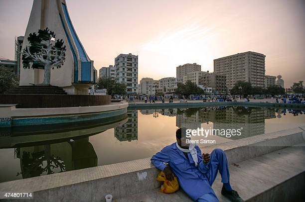 Sharjah, UAE, May 2006: Illegal day labourers congregate at 5am in Rolla Square in Sharjah in hope of being hired for the day. These workers are made...