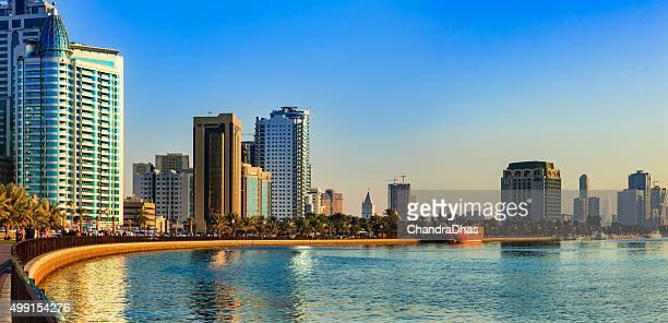 Sharjah, UAE - Panorama of Corniche at sunset.