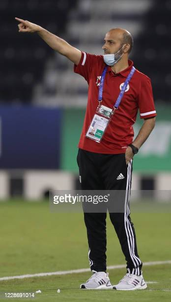 Sharjah's coach Abdulaziz Al Anberi speaks to his players during the AFC Champions League group C match between Iran's Persepolis and UAE's AlSharjah...