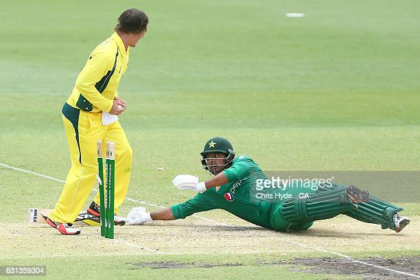 Sharjeel Khan of Pakistan is run out by Clint Hinchliffe of the CA XI during the tour match between Pakistan and the CA XI at Allan Border Field on...