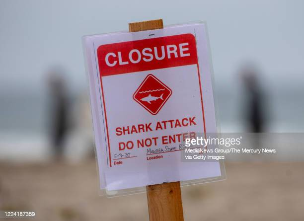 A shark attack sign is posted at the Sand Dollar Beach section of Manresa State Beach in Watsonville Calif after a surfer was killed by a shark...