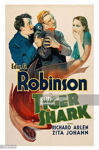 Shark in front of a pair of men struggling in front of a young girl on a poster that advertises the movie 'Tiger Shark' 1932