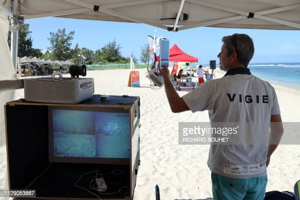 A shark lookout controls a drone ahead of the La Reunion Open Surf Championship at SaintGilles on the Indian Ocean island of La Reunion on February...