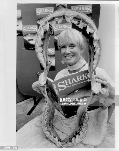 Shark lover Valerie Taylor has her teeth into another of her favourite topics as she poses behind the jaws of a 11 foot Tiger Shark during the launch...
