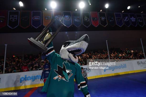Shark of the San Jose Sharks raises the trophy after winning the NHL Mascot Showdown at San Jose McEnery Convention Center on January 27 2019 in San...