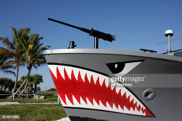 Shark teeth painted on the side of a Landing Craft Personnel Large boat at the National Navy UDTSEAL Museum