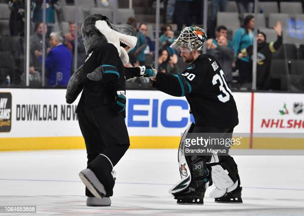 Sharkie and Aaron Dell of the San Jose Sharks celebrate their victory over the Vancouver Canucks at SAP Center on November 23 2018 in San Jose...