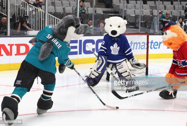 Sharkie of the San Jose Sharks Carlton the Bear of the Toronto Maple Leafs and Youppi of the Montreal Canadiens participate in the the 2019 NHL...