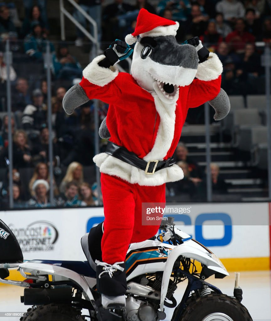 SJ Sharkie of the San Jose Sharks gets the crowd fired up in his Christmas outfit against the Colorado Avalanche during an NHL game on December 23, 2013 at SAP Center in San Jose, California.