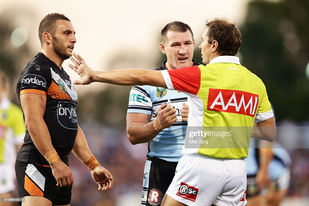 Sharks captain Paul Gallen argues with the referee as Robbie Farah of the Tigers looks on during the round five NRL match between the Wests Tigers and the Cronulla Sharks at Campbelltown Sports Stadium on April 2, 2016 in Sydney, Australia.