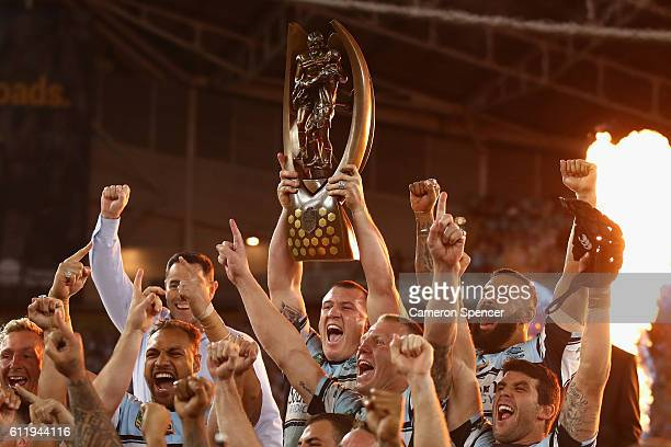 Sharks captain Paul Gallen celebrates with team mates after winning the 2016 NRL Grand Final match between the Cronulla Sharks and the Melbourne...
