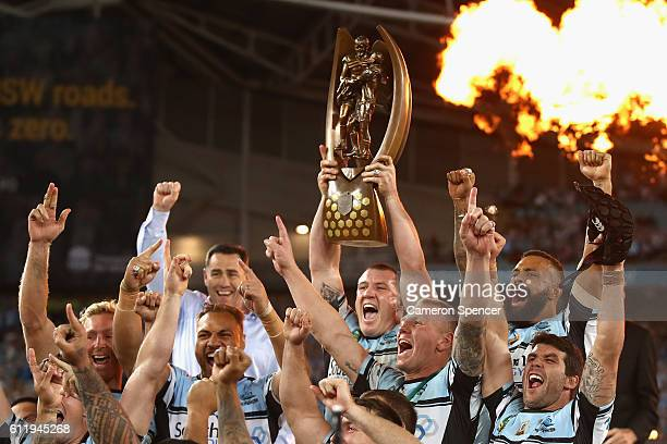 Sharks captain, Paul Gallen celebrates with team mates after winning the 2016 NRL Grand Final match between the Cronulla Sharks and the Melbourne...