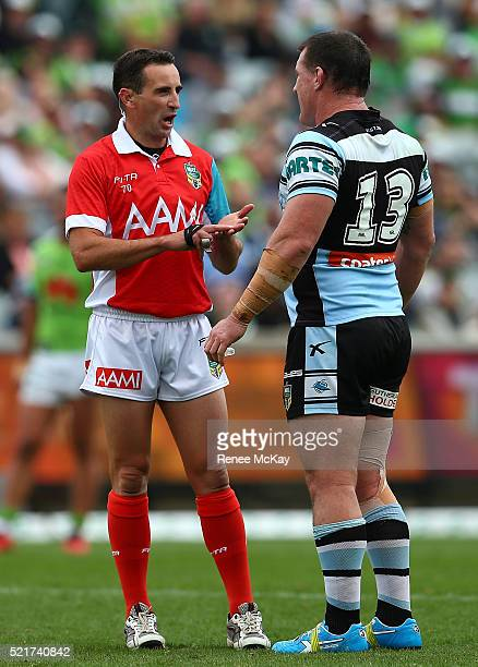 Sharks captain Paul Gallen talks with referee Gerard Sutton during the round seven NRL match between the Canberra Raiders and the Cronulla Sharks at...
