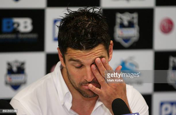 Sharks captain Trent Barrett shows his frustration as he speaks to the media at the post match press conference during the round 19 NRL match between...