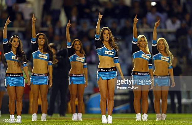 Sharks cheerleaders perform during the round 15 NRL match between the CronullaSutherland Sharks and the ManlyWarringah Sea Eagles at Remondis Stadium...