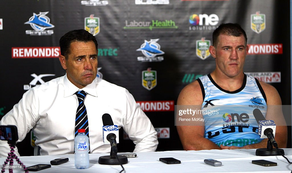 Sharks coach Shane Flanagan and captain Paul Gallen speak to the media after their teams loss at the round one NRL match between the Cronulla Sharks and the Canberra Raiders at Remondis Stadium on March 8, 2015 in Sydney, Australia.