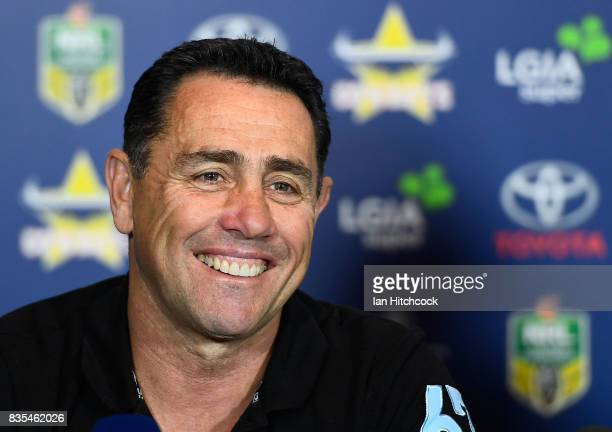 Sharks coach Shane Flanagan smiles in the post match media conference at the end of during the round 24 NRL match between the North Queensland...