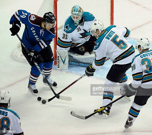 Sharks defenseman Colin White get his stick down in front of Avs wing TJ Galiardi in the first period The Colorado Avalanche hosted the San Jose...