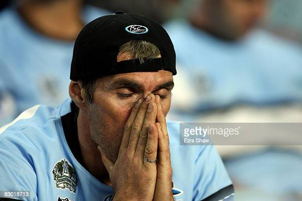 Sharks fan looks dejected after the Storm scored another try during the first NRL Preliminary Final match between the Cronulla Sharks and the...