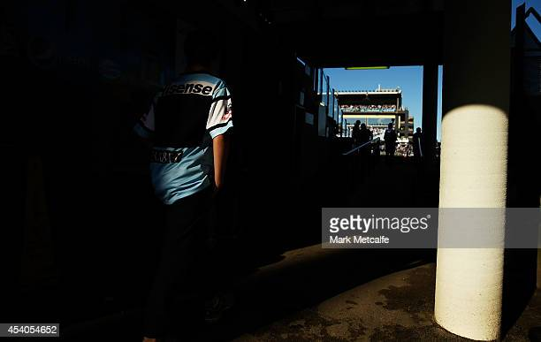 Sharks fan walks to the stadium during the round 24 NRL match between the Cronulla Sharks and the Canberra Raiders at Remondis Stadium on August 24,...