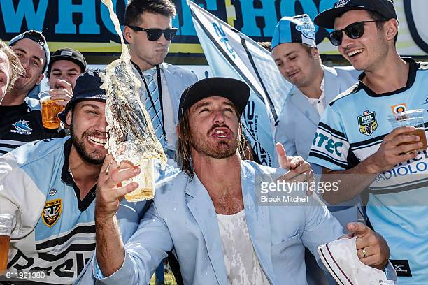 Sharks fans at Southern Cross Group Stadium get an early start to the 2016 NRL Grand Final celebrations on October 2 2016 in Sydney Australia